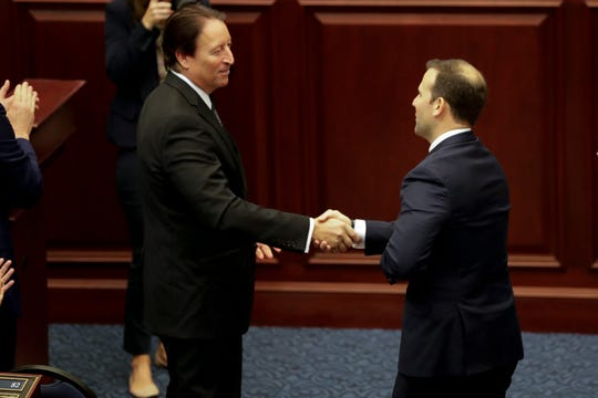 Senate President Bill Galvano shakes hands with House Speaker Designate Chris Sprowls during a House Republican Conference meeting at the Capital Tuesday, Sept. 17, 2019.