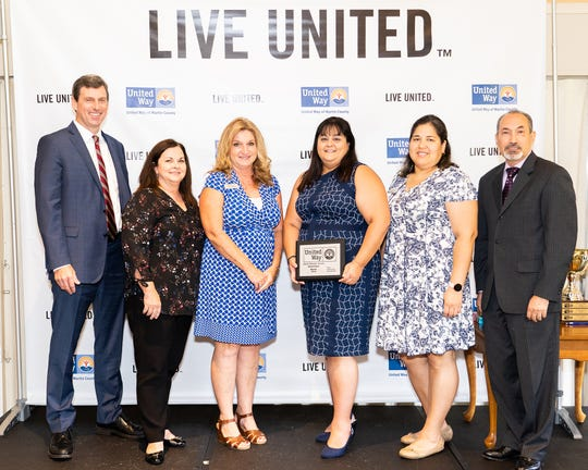 Chuck Shaffer, left, Leslie Warren, Lisa Vasquez, Denise Anderson, Erica Goyes and Ademil Castrillo, of Wells Fargo and 2018-19 Martin County United Way Campaign chair, at the Community Leaders' Breakfast at Miles Grant Country Club in Stuart.