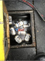 Cans of Modelo beer that were found on the boat pulling the hang glider Robin New was on the day he died.