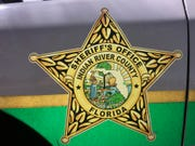 The Indian River County Sheriff's Office logo on the side of a deputy patrol vehicle.