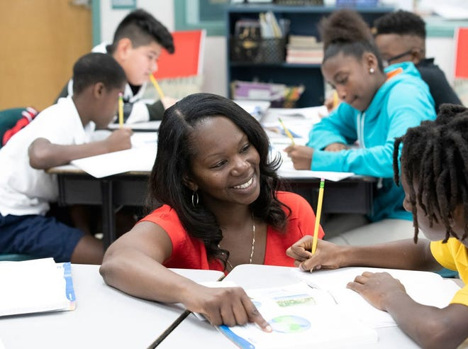 IRSC graduate Nikki Hart thrives as a fifth-grade science teacher at Chester A. Moore Elementary in Fort Pierce. The district recently took over the school's turnaround plan after the school failed to get a C grade.