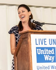 Kate Cotner, of Florida Power & Light Co., delivers remarks during the Martin County United Way Community Leaders' Breakfast, which was underwritten by FPL and held at Miles Grant Country Club in Stuart.