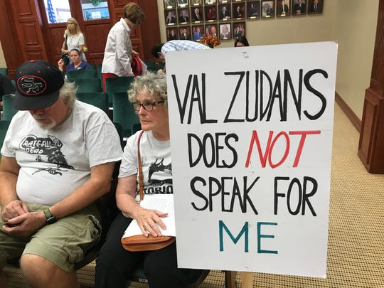 Vero Beach resident Suzanne Jones holds a sign during the Tuesday, Sept. 17, 2019, Vero Beach City Council meeting. Jones opposes a letter Mayor Val Zudans sent to the San Francisco Board of Supervisors blasting the group for its anti-National Rifle Association resolution.