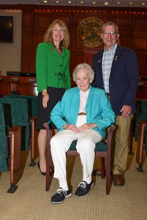 Vero Beach Centennial Celebration Co-Chairs Tammy Bursick, left, and Tony Young, right, with Parade Grand Marshal Alma Lee Loy, seated. Bursick is city clerk and Young is vice mayor of Vero Beach.