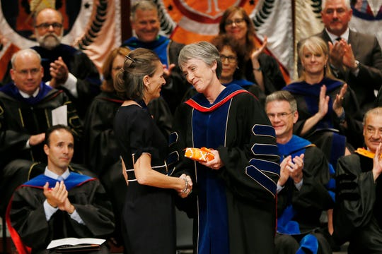 University of Texas at El Paso President Heather Wilson congratulates Martine Ceberio, associate professor of computer science, for receiving the UT System Board of Regents Outstanding Teaching Award during the annual State of the University address for the University's Fall Convocation on Tuesday, Sept. 17, 2019, at the Fox Fine Arts Center in El Paso.