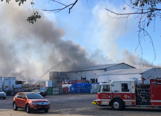 A Vineland fire truck is on the foreground in this photo of fire-fighting efforts Tuesday F&S Produce Co. on Lebanon Road in Rosenhayn. Great volumes of smoke could be seen from other counties.