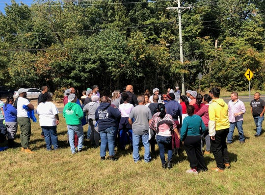 A cluster of F&S Produce workers watch fire-fighting efforts at their plant on Lebanon Road in Rosenhayn on Tuesday.