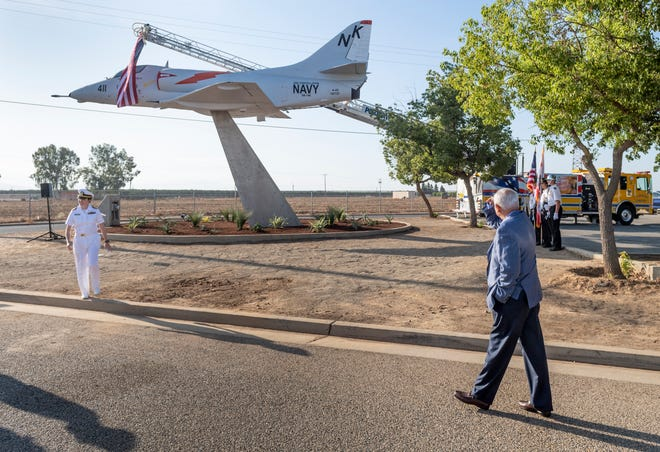 Officials gathered at Porterville Municipal Airport to unveil the newly painted A4 Skyhawk Navy aircraft on Tuesday, September 17, 2019. Retired CDR Everett Alvarez, Jr., right, a Vietnam era prisoner of war, was the honored guest and recipient of the dedication. The jet was repainted with help from Naval Air Station Lemoore.