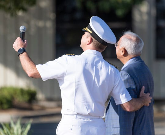 Capt. Jim Bates, Commander Strike Fighter Wing Pacific, left, and Retired CDR Everett Alvarez, Jr. look up the newly painted A4 Skyhawk Navy aircraft at Porterville Municipal Airport on Tuesday, September 17, 2019. Alvarez, a Vietnam era prisoner of war, was the honored guest and recipient of the dedication. The jet was repainted with help from Naval Air Station Lemoore.