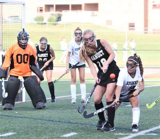 Nanuet's Meredith Lee and Yorkotwn's Maiya Munoz battle for the ball.