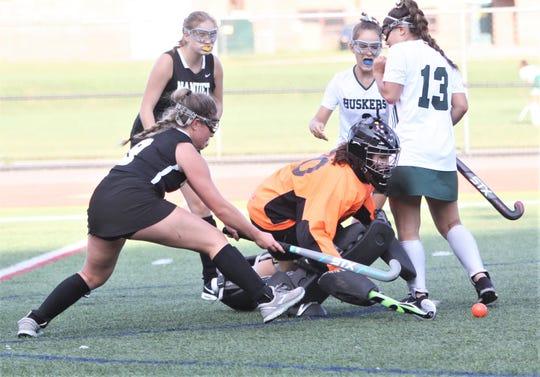 Yorktown goalie Addy Araneo and Nanuet's  Lily Kroenung pursue rebound after Araneo makes save.