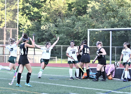 Ellie O'Donnell (12) celebrates after providing the assist to Alex Bold (1) on the Yorktown goal that tied the score at 3 with Nanuet Sept. 16, 2019.