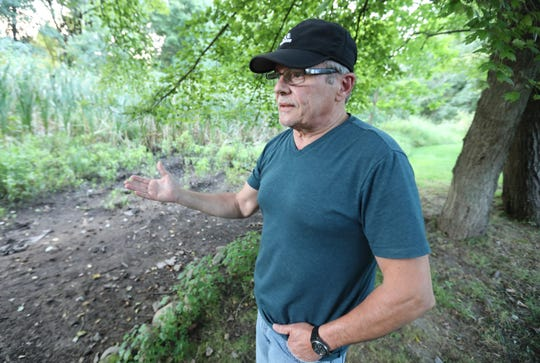 Edward Benitez near the Nauraushaun Brook behind his Nanuet home Sept. 16, 2019.