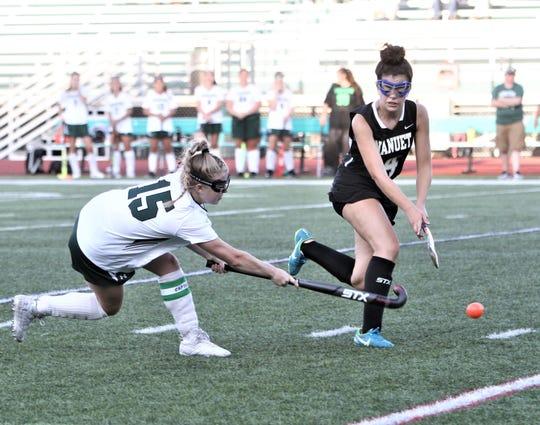 Yorktown's Kelsey McDonnell drives the ball toward the Nanuet net as Marianna Fidalgo defends..