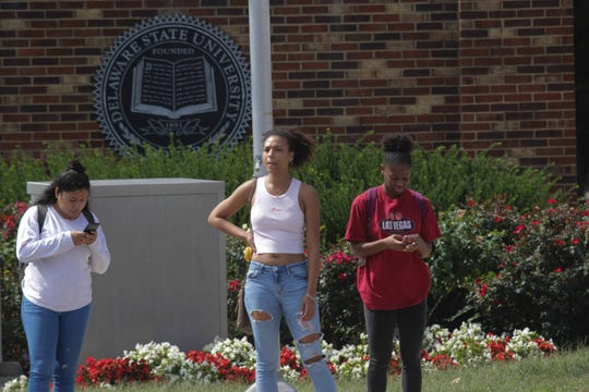 Delaware State University student's leave the Dover campus after it was put on lockdown Tuesday morning for a possible active shooter.