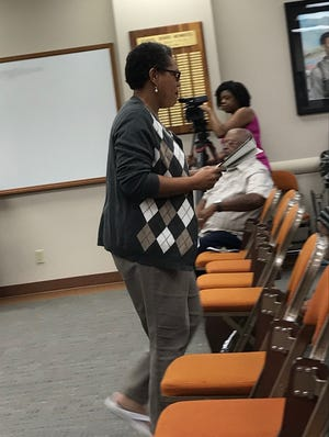 Penny Rhodes walks back to her seat after speaking to trustees about her concerns at a Wichita Falls ISD Board meeting as shown in this Sept. 17, 2019, file photo.