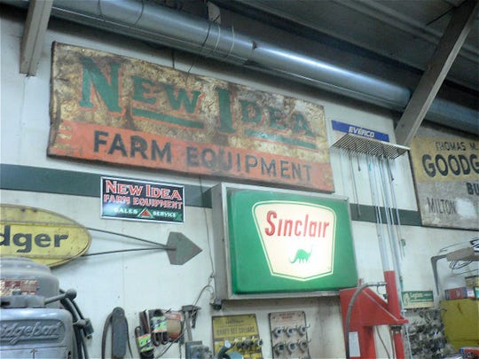 Old farm signs are bought and sold.