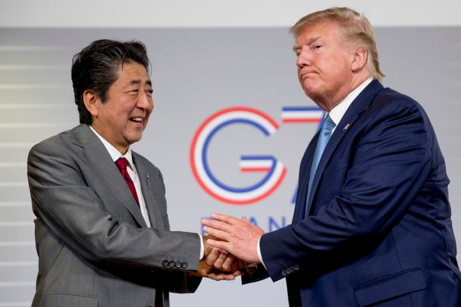 U.S President Donald Trump and Japanese Prime Minister Shinzo Abe shake hands following a news conference at the G-7 summit in Biarritz, France to announce that the U.S. and Japan have agreed in principle on a new trade agreement. On Tuesday, Sept. 17, 2019, officials in Japan appear wary over the prospects for a trade deal with the U.S. after President Donald Trump said he was prepared to sign a pact soon.