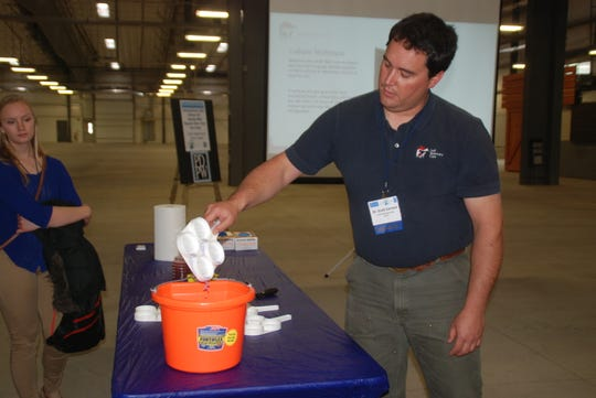 Lodi veterinarian Dr. Scott Earnest demonstrated the use of the California Mastitis Test or CMT - a key tool in determining milk quality. He recommends testing cows with the CMT paddle and reagent, along with routine bulk tank cultures, testing and culturing cows with known high cell counts and treatment or culling of those animals.
