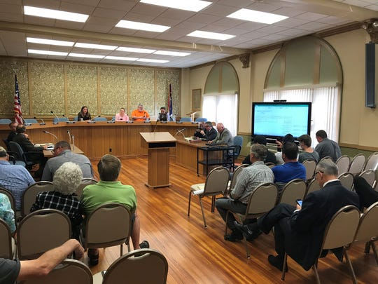 The Public Safety Committee met in council chambers Monday afternoon to discuss a plan to save three 600 block Main Street buildings with their new owner.