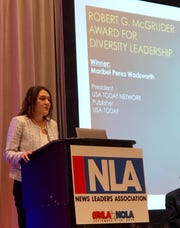 USA TODAY Network President Maribel Perez Wadsworth accepts the Robert G. McGruder Award for Diversity Leadership in New Orleans on Sept. 10, 2019.