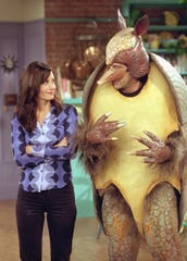 Not to be outdone by Chandler's Santa, Ross invents his own mascot, the Holiday Armadillo.