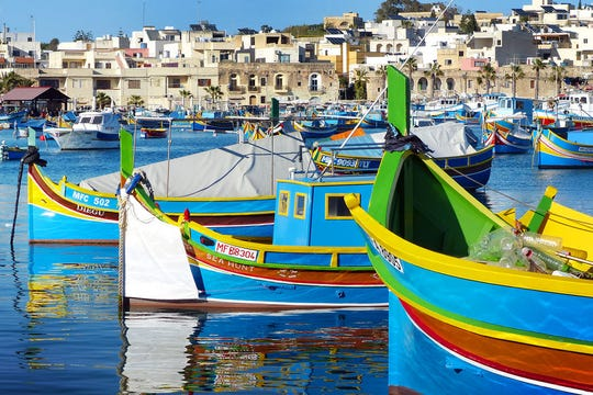 According to tradition, the colors of these Maltese fishing boats represent a fisherman's home village. (photo: