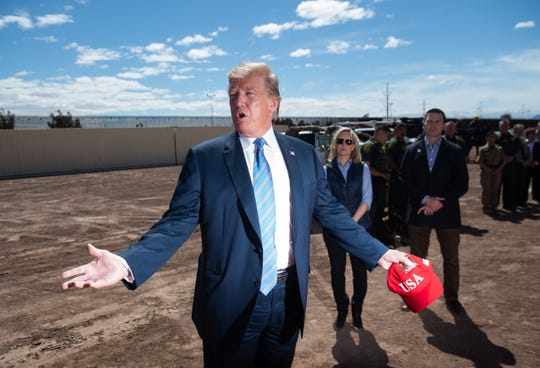 President Donald Trump tours the border wall between the United States and Mexico in Calexico, California, on April 5, 2019.