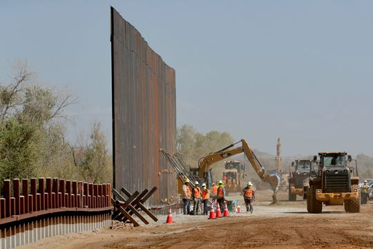 Government contractors erect a section of the border wall on Sept. 10, 2019, in Yuma, Arizona.