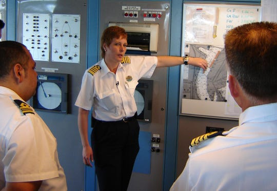 Captain Karin Janson briefs her officers on the departure procedure on the bridge of the Royal Caribbean cruise ship Monarch of the Seas.