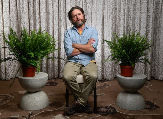 """Galifianakis plays an awkward interviewer in """"Between Two Ferns: The Movie,"""" but he's in the interviewee seat to promote his movie."""