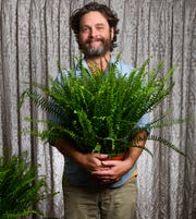 """Zach Galifianakis shows his love for his ferns during a photo shoot ahead of the release of """"Between Two Ferns: The Movie."""""""