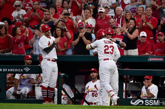 Sept. 16: St. Louis Cardinals left fielder Marcell Ozuna is congratulated by teammates after hitting a home run off of Washington Nationals starting pitcher Stephen Strasburg during the first inning at Busch Stadium. Sports