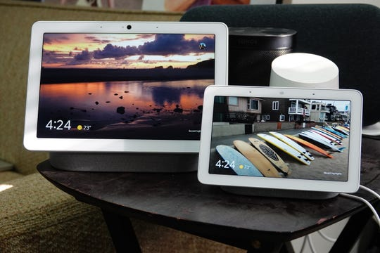 The new Google Nest Hub Max, with a ten-inch screen, back to back with the old Nest Hub, with a 7-inch screen.
