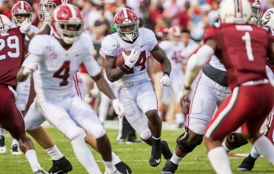 Alabama running back Brian Robinson Jr. carries the ball against South Carolina at Williams-Brice Stadium.
