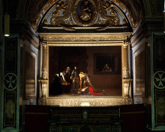 """""""The Beheading of St. John the Baptist"""" by Caravaggio was painted during the artist's stay on the island of Malta."""