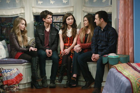 """Cory (Ben Savage) and Topanga (Danielle Fishel), at right, returned in the """"Boy Meets World"""" sequel,  """"Girl Meets World."""" The Disney Channel show features the classic couple raising their daughter, Riley."""