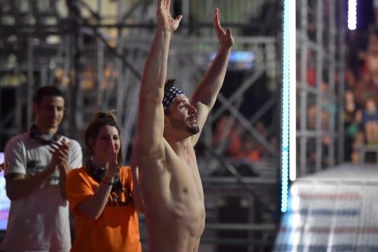Drew Drechsel celebrates his victory as girlfriend April Beckner looks on.
