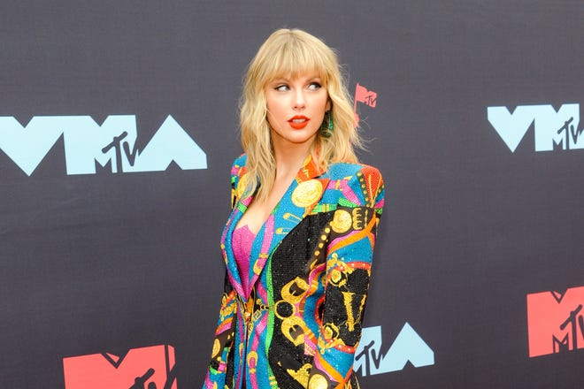 A dismissed lawsuit claiming copyright infringement by Taylor Swift, seen here at MTV Video Music Awards in August, was given new life by federal appeals court judges on Monday.