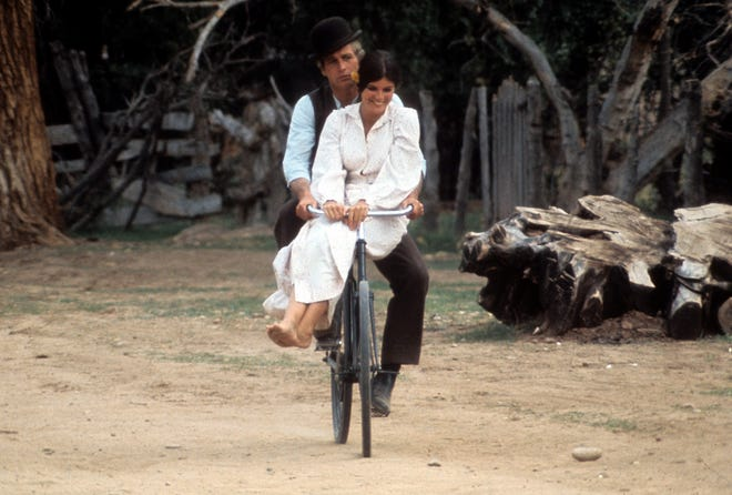 ONE TIME USE ONLYPaul Newman and Katharine Ross double riding on a bicycle in a scene from the film 'Butch Cassidy and the Sundance Kid', 1969. (Photo by 20th Century-Fox/Getty Images)