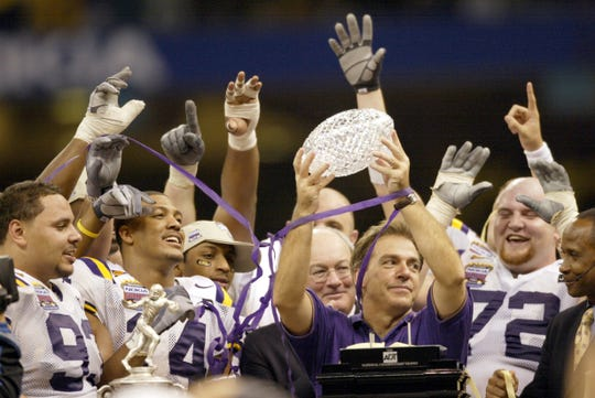 Nick Saban celebrates with with LSU's championship trophy in January 2004.