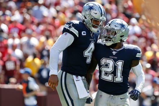 Cowboys quarterback Dak Prescott, left, celebrates with running back Ezekiel Elliott after throwing a touchdown pass against the Redskins in Week 2.
