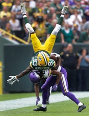 Packers receiver Marquez Valdes-Scantling is knocked out of bounds by Vikings cornerback Trae Waynes for an incomplete pass Sunday.