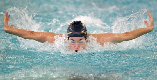 Appleton North's Mollie Brackett competes in the 100-yard butterfly against Oshkosh West during a Fox Valley Association dual meet Sept. 17 in Appleton.