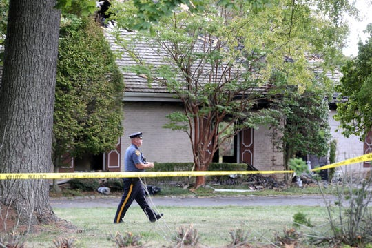 A search continues at the Wickapecko Drive home of Jacquelin Terrulli, who has been missing since the September 12th fire at the home, in Ocean Twp., NJ Wednesday, September 18, 2019. Ronald Teschner, 49, who also lived in the home, was found in possession of Terrulli's 2019 Jeep Cherokee and shotguns also were located in the vehicle, according to a statement from the Prosecutor's Office.