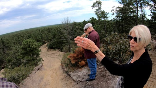 Ocean County Freeholder director Virginia E. Haines points out to the Pine Barrens from the top of the Forked River Mountains in Lacey Township Monday, September 16, 2019