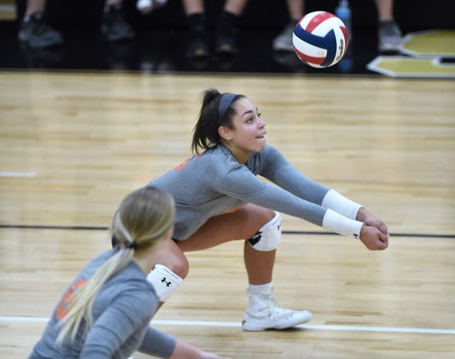 San Angelo Central's Mya Moore (5) bumps a pass against Abilene High at Eagle Gym on Tuesday, Sept. 17, 2019. The Lady Cats won in straight sets.