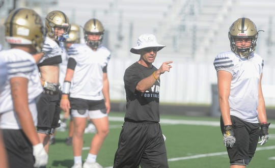 Clyde football coach Scott Campbell instructs players during practice Tuesday at Bulldog Stadium.