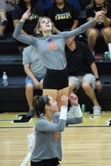 San Angelo Central's Presley Knowlton goes up for a kill against Abilene High at Eagle Gym on Tuesday, Sept. 17, 2019. Knowlton had a match-high 13 kills as the Lady Cats won in straight sets.