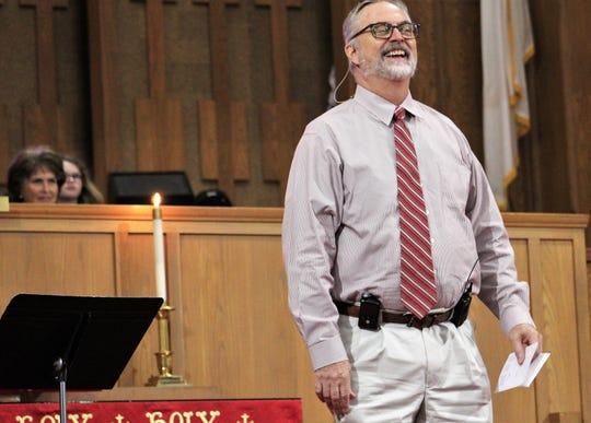 The Rev. Scott Seymour shares a laugh with his congregation Sunday at First UMC.
